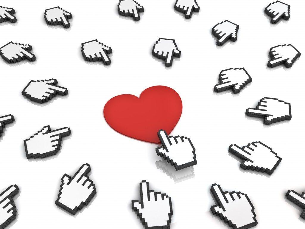 mouse pointer clicking a heart button