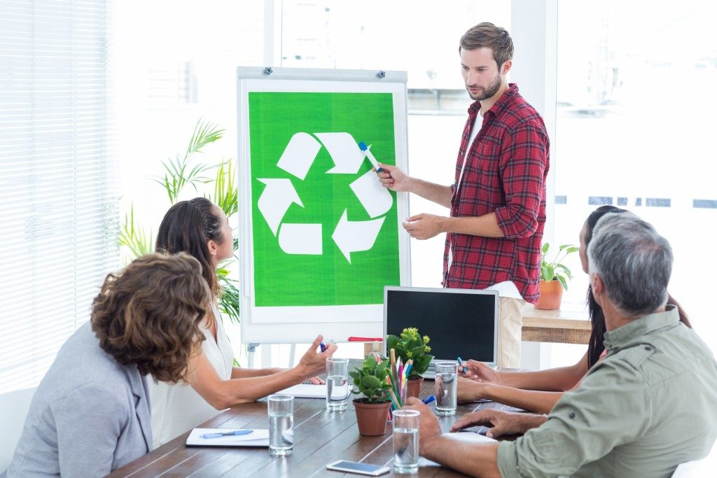 Team having a meeting about recycling