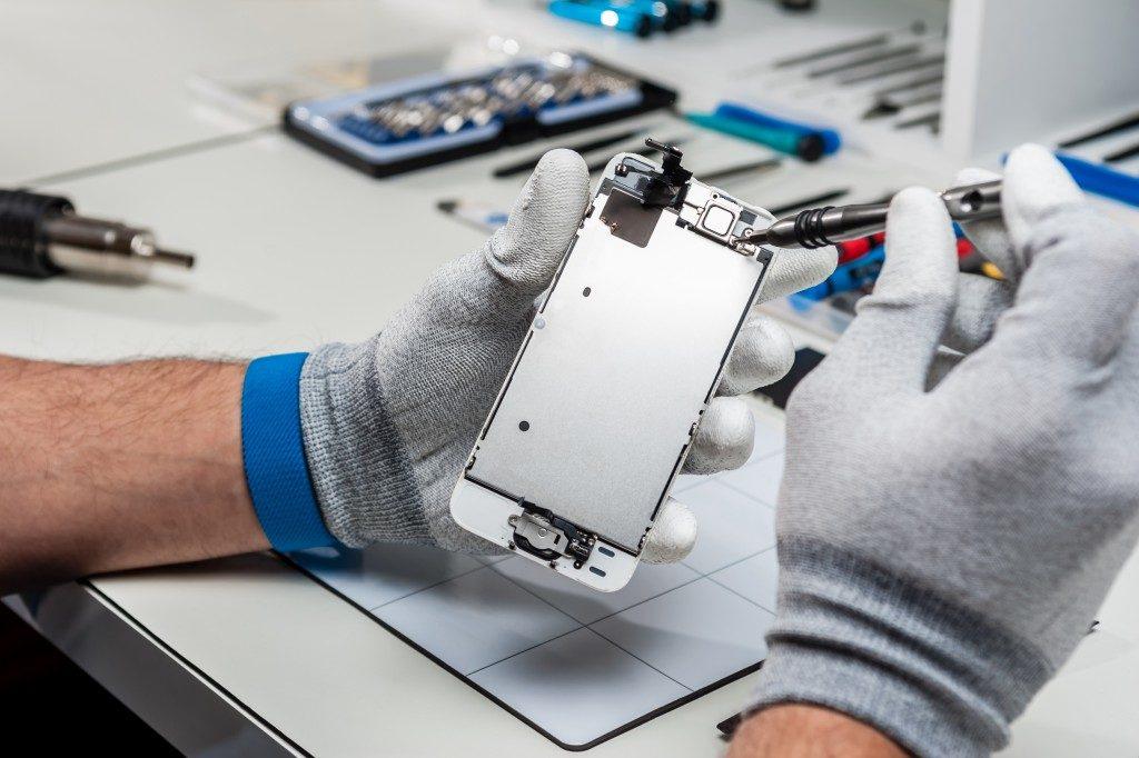 Man repairing a phone