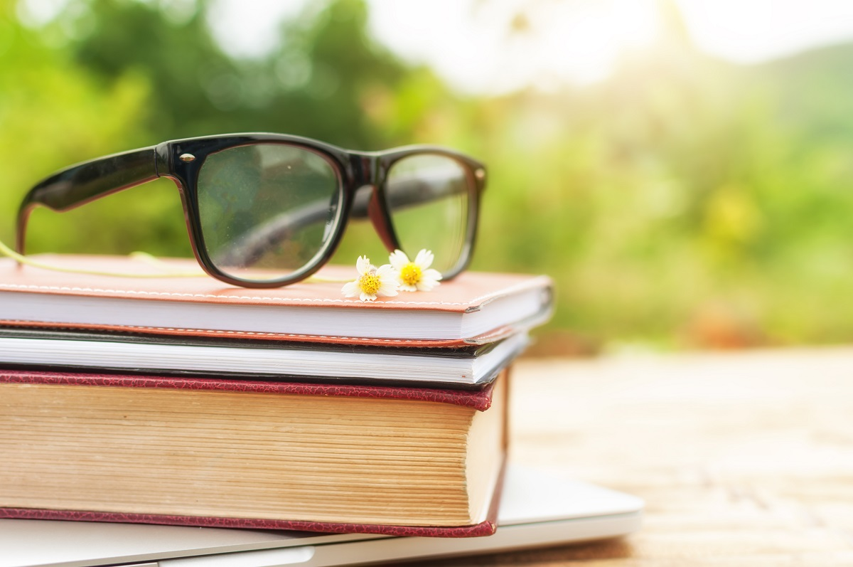 Glasses on top of books and notebooks