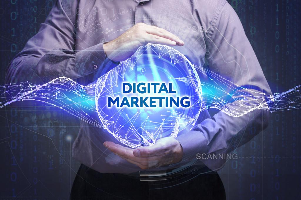 "man holding a circular hologram with ""digital marketing"" written on it"